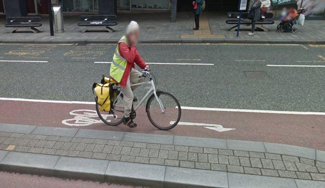 Cyclist on Phone.JPG