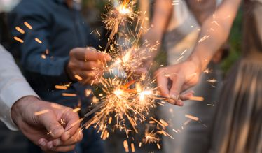 Wear gloves when handling sparklers - unlike the people in this picture!